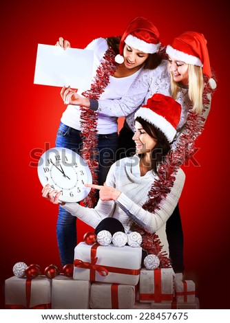 Girls with a new year gift on a dark background - stock photo