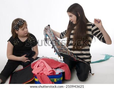 Girls with luggage on white background - stock photo