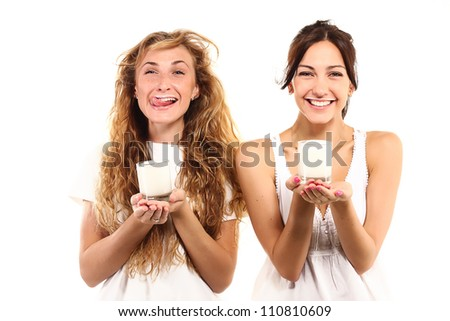 Girls with milk isolated - stock photo