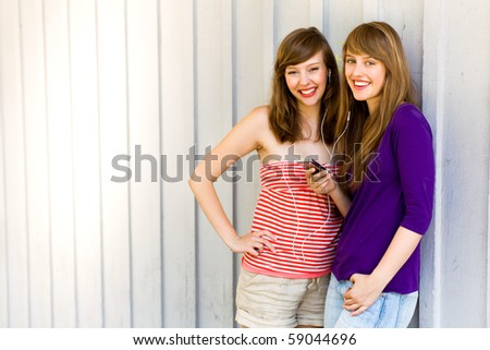 Girls with mp3 player - stock photo