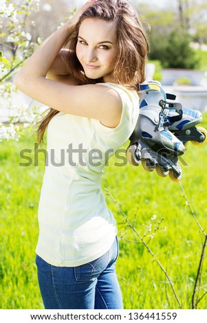 Girls with roller-skates on the nature - stock photo