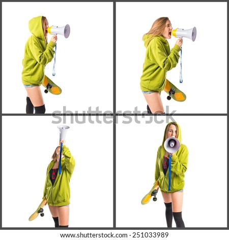 Girls with skate shouting by megaphone  - stock photo