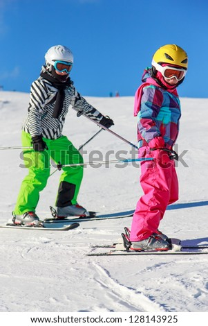 Girls with ski on the mountain - stock photo