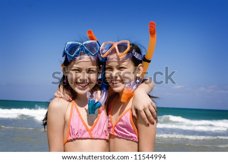 Girls with snorkel at the beach - stock photo