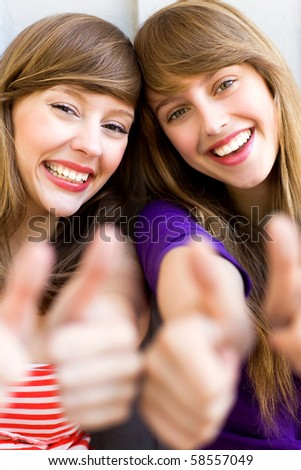 Girls with thumbs up - stock photo
