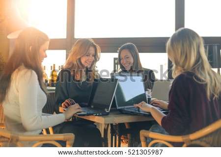 Girls working at their laptops