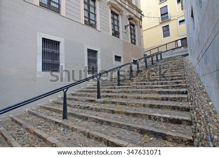 GIRONA, SPAIN - AUGUST 30, 2012: Stairs in Jewish quarter in Girona. Catalonia. Spain