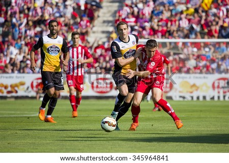 GIRONA, SPAIN - JUNE 7: Alex Granell (R) of Girona in action at the Spanish Second Division League match between Girona FC and CD Lugo, final score 1 - 1, on June 7, 2015, in Girona, Spain. - stock photo