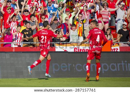 GIRONA, SPAIN - JUNE 7: Fran Sandaza of Girona celebrating his goal at the Spanish Second Division League match between Girona FC and CD Lugo, final score 1 - 1, on June 7, 2015, in Girona, Spain. - stock photo