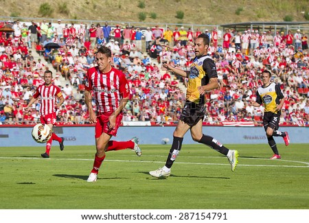 GIRONA, SPAIN - JUNE 7: Jaime Mata (L) of Girona in action at the Spanish Second Division League match between Girona FC and CD Lugo, final score 1 - 1, on June 7, 2015, in Girona, Spain. - stock photo