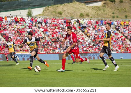 GIRONA, SPAIN - JUNE 7: Jaime Mata (middle) of Girona in action at the Spanish Second Division League match between Girona FC and CD Lugo, final score 1 - 1, on June 7, 2015, in Girona, Spain. - stock photo