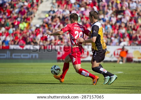 GIRONA, SPAIN - JUNE 7: Pere Pons (L) of Girona in action at the Spanish Second Division League match between Girona FC and CD Lugo, final score 1 - 1, on June 7, 2015, in Girona, Spain. - stock photo