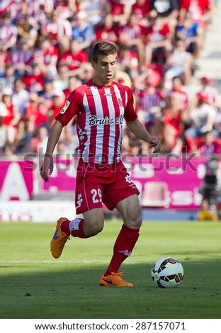 GIRONA, SPAIN - JUNE 7: Pere Pons of Girona in action at the Spanish Second Division League match between Girona FC and CD Lugo, final score 1 - 1, on June 7, 2015, in Girona, Spain. - stock photo