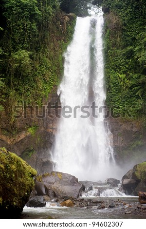 Gitgit Waterfall is a beautiful waterfall located in plateau area and it is one of places of interest in north part of Bali - stock photo