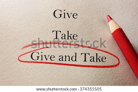 Give and Take red pencil circle on textured paper -- compromise concept                               - stock photo
