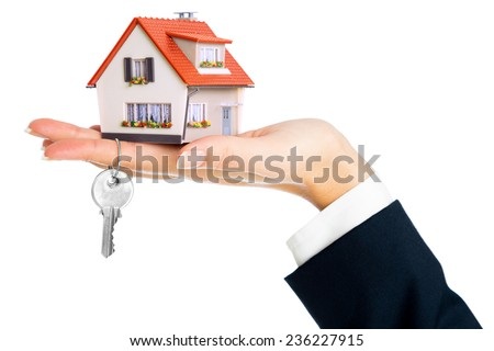 give house and key - concept of real estate purchase  - stock photo