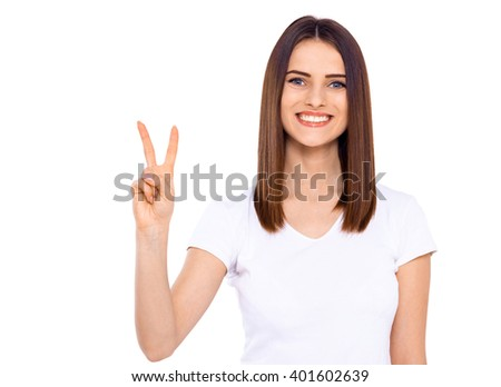 Give peace a chance. Portrait of a pretty young woman showing the peace sign on white background. - stock photo
