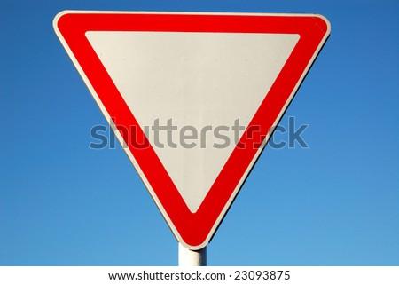 Give way sign closeup - stock photo