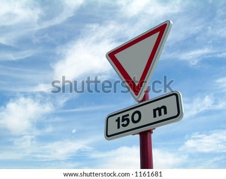 Give way to 150 m. signal over a cloudy sky