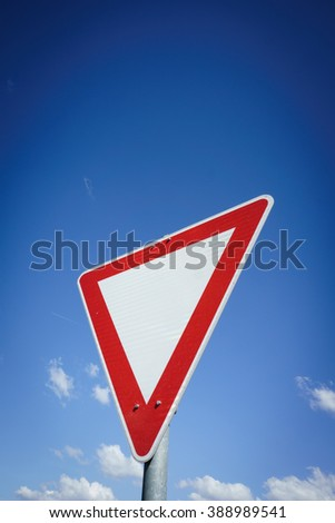 give way traffic sign, yield - stock photo