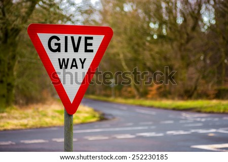 Give Way Uk Road sign with blurred background - stock photo