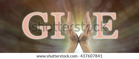 Give what you can fund raising banner - female hands making the V of GIVE on a warm bokeh effect background with light behind the hands - stock photo