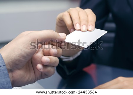 Gives a credit card - stock photo