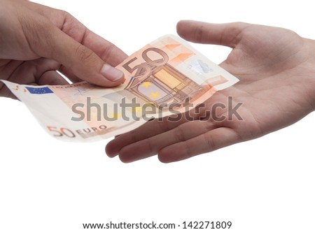 Giving euro money from hand to hand - stock photo