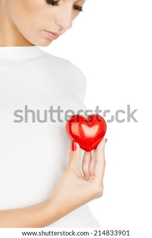 Giving love concept with hand holding a red heart. - stock photo