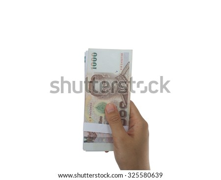 Giving money, money in hand outstretched in front of a white background. Focus on the subject in hand. - stock photo
