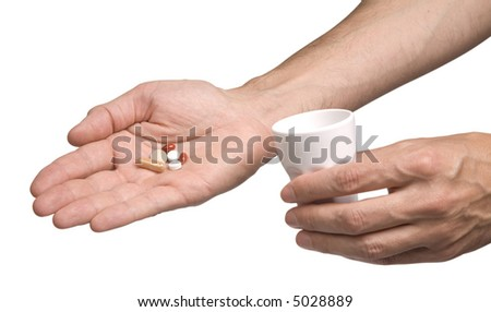 Giving pills to patient. Photo with clipping path.