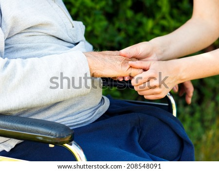 Giving support and care for elderly with Alzheimer's disease.  - stock photo