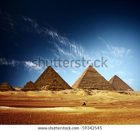 Giza valley with Great pyramids and blue sky with clouds - stock photo