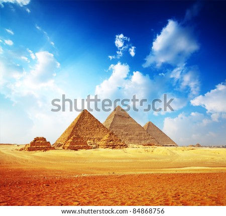 Giza valley with Great pyramids with blue cloudy sky - stock photo
