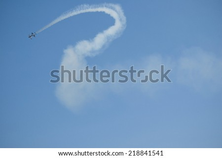 GIZYCKO, POLAND - AUGUST 02: Czech flying team on SBach 342 ( XA-42) - Flying Bulls Aerobatic DUO during Mazury AirShow 2014 event on August 02, 2014 in Gizycko, Poland