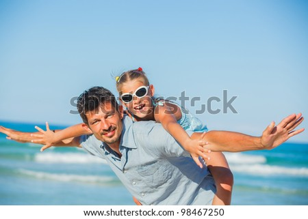 Gjebexbh daughter having fun on tropical beach - stock photo