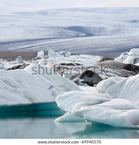 Glacial ice and old glacier in Iceland - stock photo