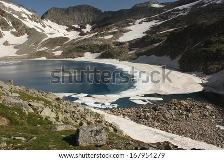 glacial lake ibon blanco de lliterola, pyrenees - stock photo
