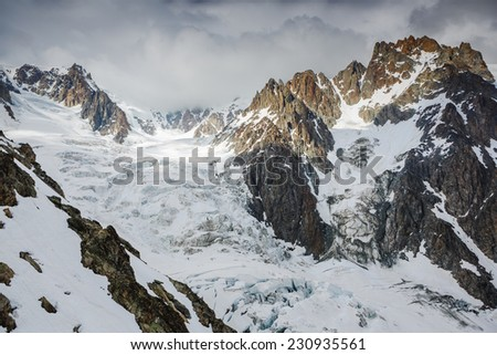 Glacier and snow capped mountains in Mont Blanc region. Alps - stock photo