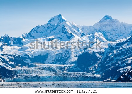 Glacier and snow capped mountains in the Glacier Bay National Park, Alaska - stock photo