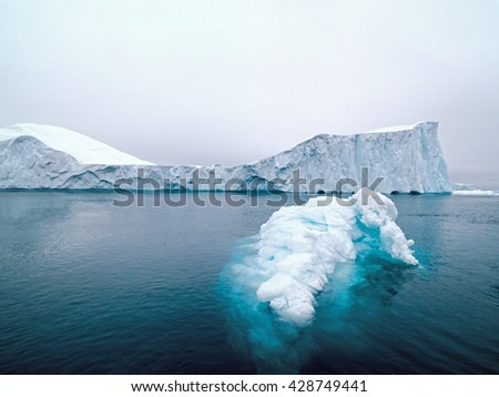 Glacier at north pole of the world in Greenland, Glaciers are melting day by day. - stock photo