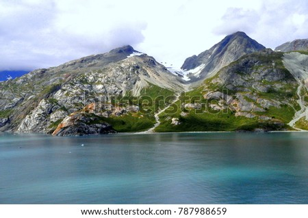 Glacier Bay, Alaska, U.S.A - August 20, 2013 - Scenic view of the ocean and the mountain in the summer