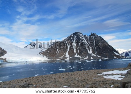 Glacier melting into an inlet in Antarctica - stock photo
