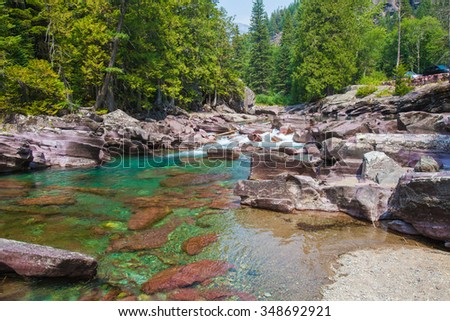 Glacier National Park. Turquoise river flowing towards Lake McDonald  - stock photo