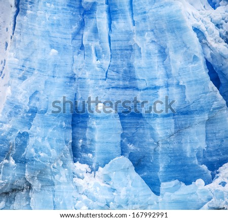 Glacier Perito Moreno in Argentina, blue icy background and texture. - stock photo