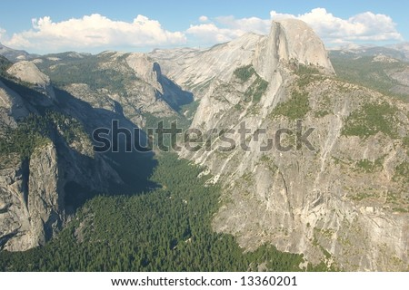 Glacier Point is a viewpoint above Yosemite Valley, in California, USA. It is located on the south wall of Yosemite Valley at an elevation of 7,214 ft (2,199 m), 3,200 ft (975 m) above Curry Village. - stock photo