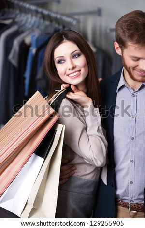 Glad beautiful woman is in the shop with her boyfriend - stock photo