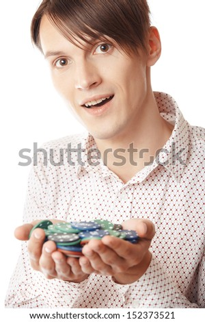 Glad man holding casino chips on a white background - stock photo