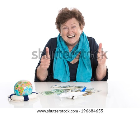Glad older woman portrait: concept for money and traveling.