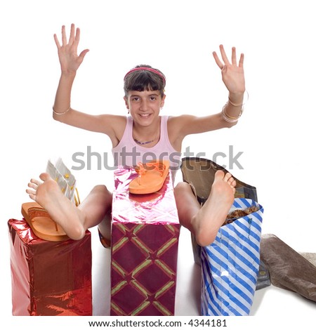 Glad young child with gifts after shopping - stock photo